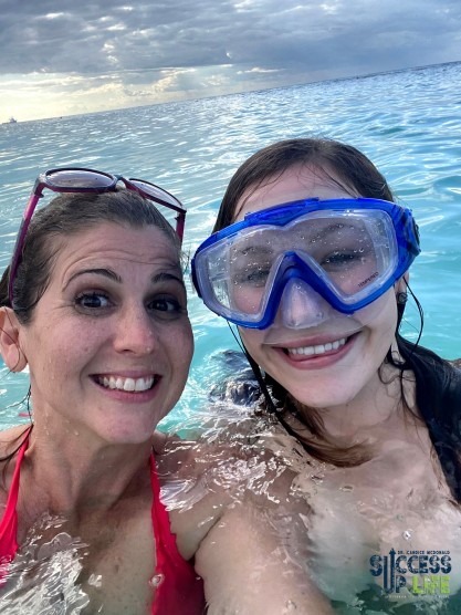 Julie helping Dr. Candice's iPhone in the ocean